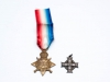 Memorial Cross (issued to mothers of Canadian soldiers who died in World War I) and 1914 – 15 Star (awarded to British/Canadian soldiers who were in an active theatre of war between 5 August 1914 and December 1915. Many Canadians in the 1st and 2nd Contingent received this medal. Both of these medals are named to 6688 Pte. James Heather of Chatham who enlisted in the 1 st Battalion in September 1914 and went overseas with the 1st Contingent. He was killed in 1916. Heather's father and brother (both named Samuel) were also killed in the war. (Front)