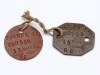 "Pair of WW I ""dog tags"" worn by 880559 Pte. J.A. Sugrue, a barber from Chatham who enlisted with the 186th Kent Overseas Battalion and served in France with the 18th Battalion."