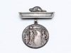 """Sterling silver """"welcome home"""" medal presented by the town of Wallaceburg to those who had served in WW I (it was also given to the next of kin of those who were killed). This medal was awarded to H. Murphy. (Front)"""